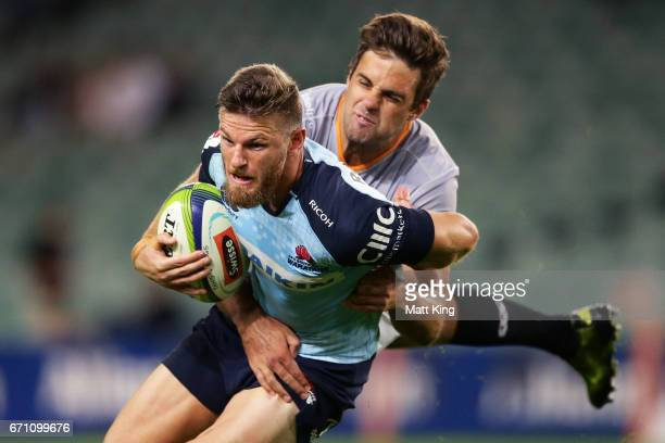 Rob Horne of the Waratahs is tackled by Nicolaas Hanekom of the Kings during the round nine Super Rugby match between the Waratahs and the Kings at...