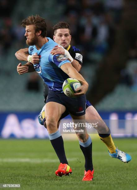 Rob Horne of the Waratahs is tackled during the round 12 Super Rugby match between the Waratahs and the Hurricanes at Allianz Stadium on May 3, 2014...