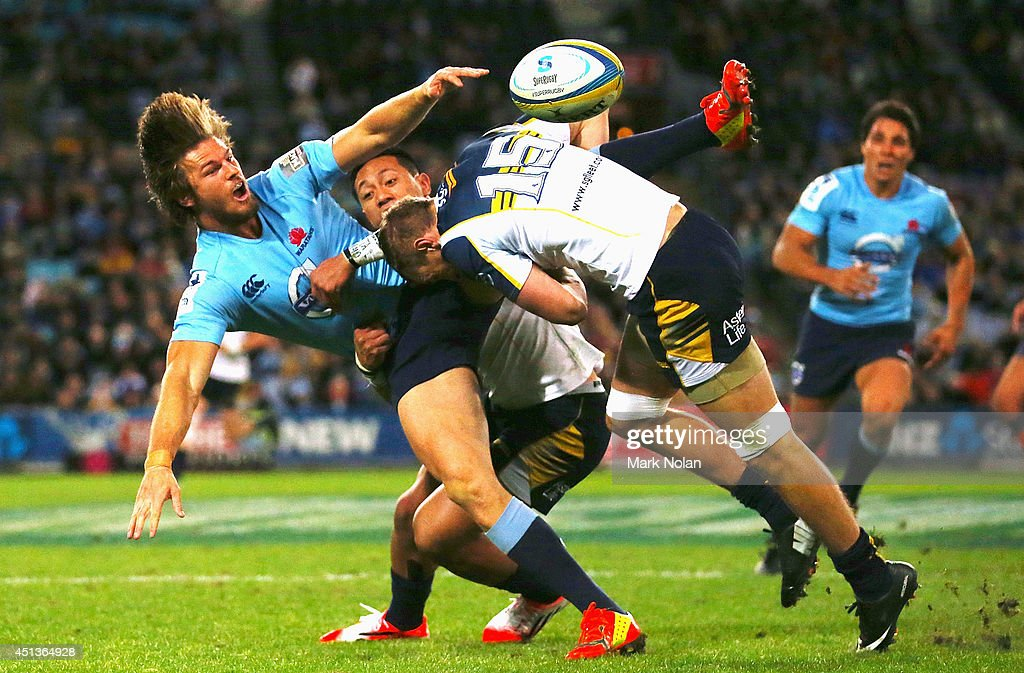 Rob Horne of the Waratahs offloads in a tackle during the round 17 Super Rugby match between the Waratahs and the Brumbies at ANZ Stadium on June 28, 2014 in Sydney, Australia.