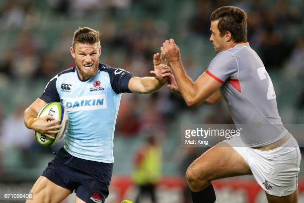 Rob Horne of the Waratahs puts a fend on Nicolaas Hanekom of the Kings during the round nine Super Rugby match between the Waratahs and the Kings at...
