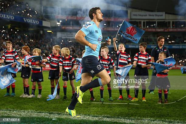Rob Horne of the Waratahs runs onto the field during the Super Rugby Semi Final match between the Waratahs and the Highlanders at Allianz Stadium on...