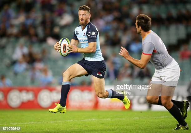 Rob Horne of the Waratahs runs with the ball during the round nine Super Rugby match between the Waratahs and the Kings at Allianz Stadium on April...