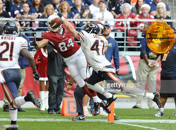 Rob Housler of the Arizona Cardinals attempts to make a catch while being defended by Chris Conte of the Chicago Bears at University of Phoenix...
