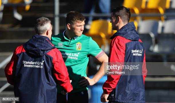 Rob Howley the Lions backs coach talks to Owen Farrell and Jonathan Sexton during the British Irish Lions training session at Porirua Park on June 29...