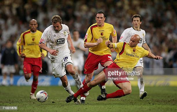 Rob Hulse of Leeds is tackled by Watford's Gavin Mahon during the CocaCola Championship Playoff Final between Leeds United and Watford at the...