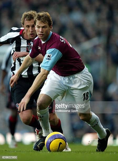Rob Hulse of West Ham United and Jonathon Spector of Sheffield United in action during the Barclays Premiership match between West Ham United and...