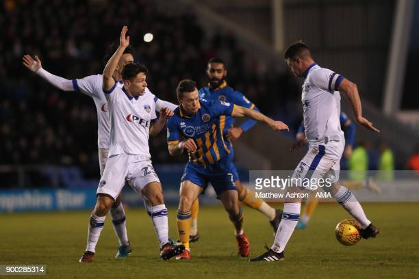 Rob Hunt of Oldham Athletic and Anthony Gerrard of Oldham Athletic try and contain Shaun Whalley of Shrewsbury Town during the Sky Bet League One...