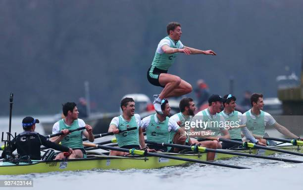 Rob Hurn jumps from the boat as the Cambridge University Men's Boat Club Blue crew celebrate race victory over Oxford University Men's Boat Club Blue...