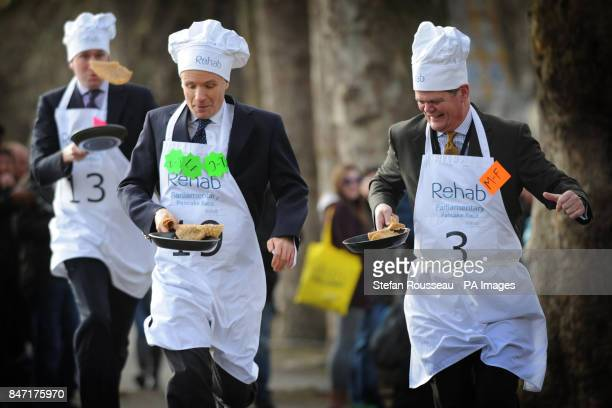Rob Hutton from Bloomberg Lord Listowel and Stephen Lloyd MP take part in the annual Parliamentary Pancake Race in Westminster today raising money...