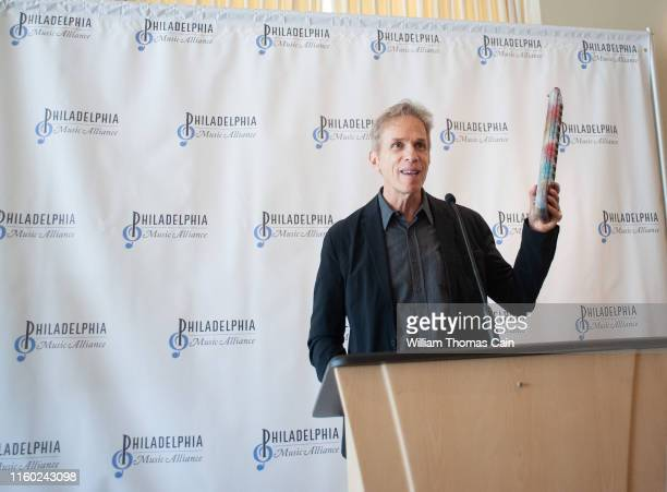 Rob Hyman of The Hooters holds a Hohner melodica as he speaks with the media after his band was nominated for induction during the announcement of...
