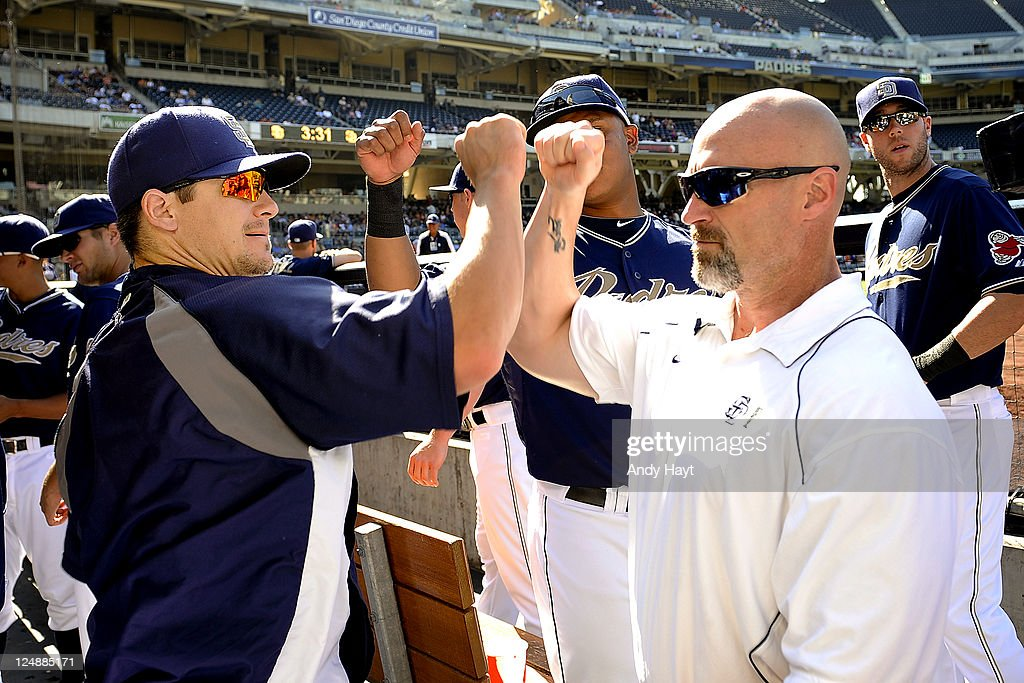Rob Johnson and Jim Malone of the San Diego Padres greet