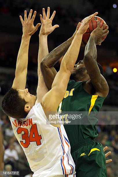Rob Johnson of the Norfolk State Spartans attempts a shot in the first half againnst Cody Larson of the Florida Gators during the third round of the...