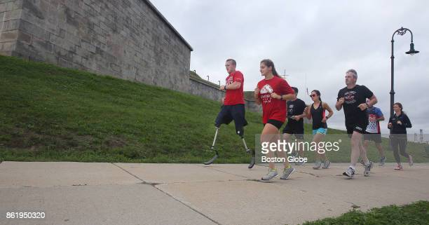 Rob Jones a double amputee Marine veteran runs around Castle Island in Boston with supporters as he continues running his 31 marathons in 31 days in...