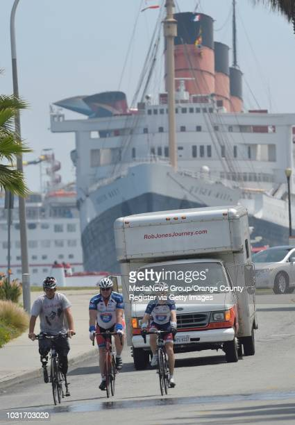 Rob Jones a double amputee Marine veteran who lost both legs in Afghanistan rides on Queensway Drive with and Hugh McLarnon center and Ray Clark on...