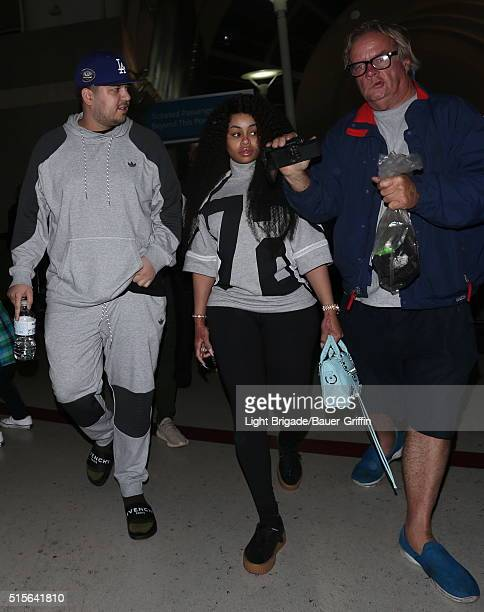 Rob Kardashian and Blac Chyna are seen at LAX Airport in Los Angeles Ca on March 14 2016 in Los Angeles California