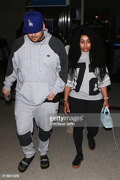 Rob Kardashian and Blac Chyna are seen at LAX on March 14 2016 in Los Angeles California