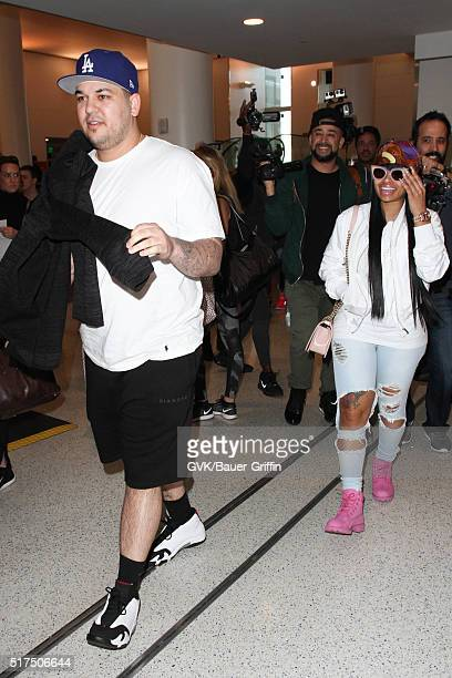 Rob Kardashian and Blac Chyna are seen at LAX on March 25 2016 in Los Angeles California