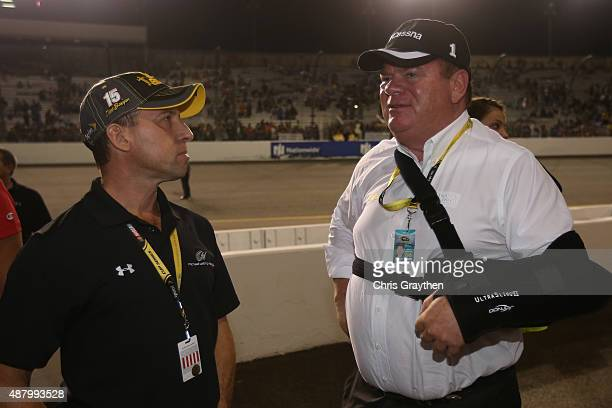 Rob Kauffman a team owner talks to Chip Ganassi after the NASCAR Sprint Cup Series Federated Auto Parts 400 at Richmond International Raceway on...