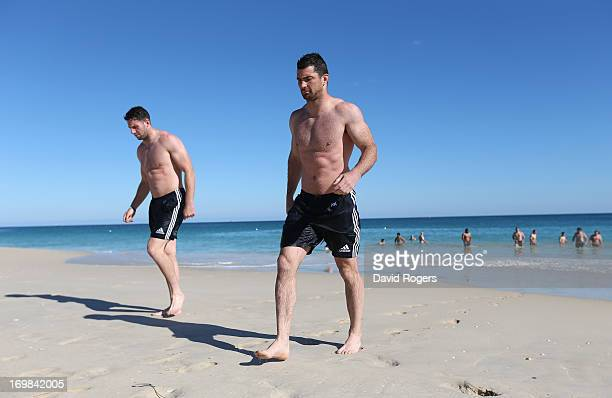 Rob Kearney and Alex Cuthbert walk out of the ocean during the British and Irish Lions swimming session at City Beach on June 3 2013 in Perth Western...