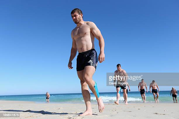 Rob Kearney leads his team mates up the beach during the British and Irish Lions swimming session at City Beach on June 3 2013 in Perth Western...