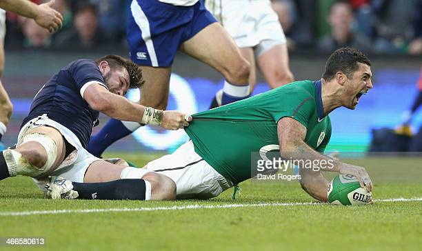 Rob Kearney of Ireland dives over for a try during the RBS Six Nations match between Ireland and Scotland at the Aviva Stadium on February 2 2014 in...