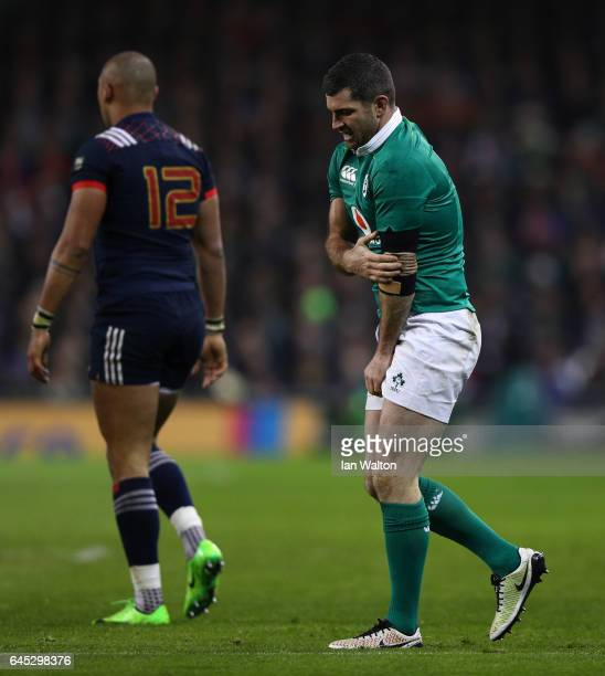 Rob Kearney of Ireland injures himself whilst tackling Gael Fickou of France during the RBS Six Nations match between Ireland and France at the Aviva...
