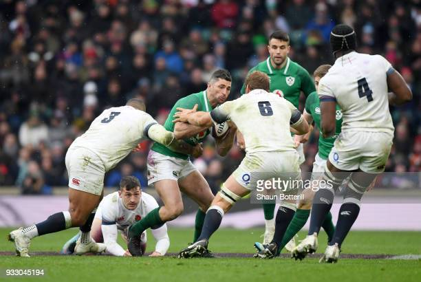 Rob Kearney of Ireland is tackled by Kyle Sinckler of England and Chris Robshaw of England during the NatWest Six Nations match between England and...