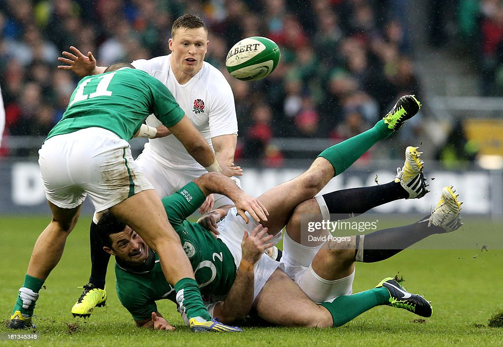 Rob Kearney of Ireland offloads as he is tackled during the RBS Six Nations match between Ireland and England at Aviva Stadium on February 10, 2013 in Dublin, Ireland.
