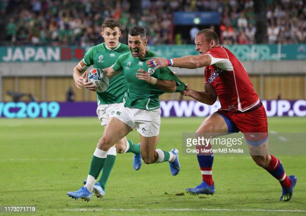 Rob Kearney of Ireland scores his side's first try despite the tackle of Denis Simplikevich of Russia during the Rugby World Cup 2019 Group A game...