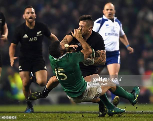 Rob Kearney of Ireland tackles TJ Perenara of New Zealand during the International match between Ireland and New Zealand All Blacks at Aviva Stadium...
