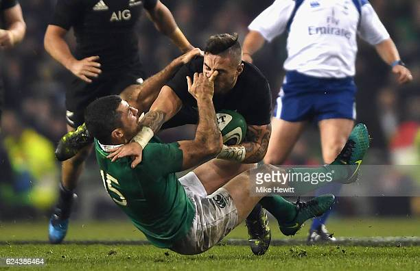 Rob Kearney of Ireland tackles TJ Perenara of New Zealand during the International match between Ireland and New Zealand All Blacks at Aviva Stadium...