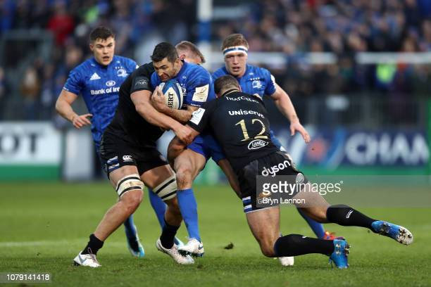 BATH ENGLAND DECEMBER Rob Kearney of Leinster is tackled by Tom Ellis and Jamie Roberts of Bath during the Champions Cup match between Bath Rugby and...