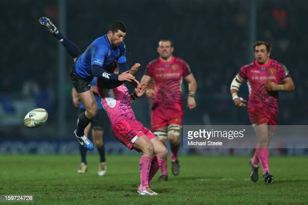Rob Kearney of Leinster knocks on from a high ball under the challenge of Luke Arscott of Exeter Chiefs during the Heineken Cup Pool Five match...