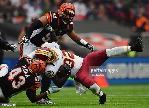 Rob Kelley of the Washington Redskins is tackled by George Iloka of the Cincinnati Bengals during the NFL International Series Game between...