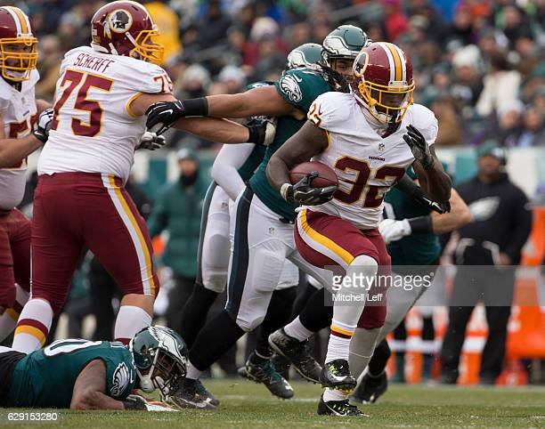 Rob Kelley of the Washington Redskins runs past Marcus Smith and Destiny Vaeao of the Philadelphia Eagles on his way to a touchdown in the second...