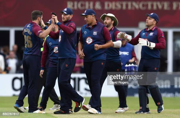 Rob Keogh of Northamptonshire celebrates with team mates after catching out Cameron Delport during the NatWest T20 Blast match between the...