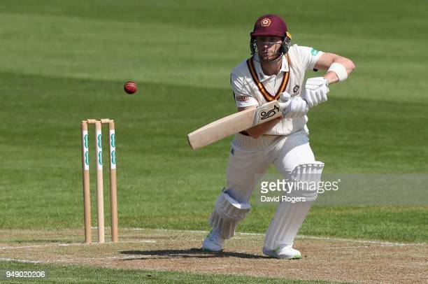 Rob Keogh of Northamptonshire drives the ball during the Specsavers County Championship division two match between Northamptonshire and Warwickshire...