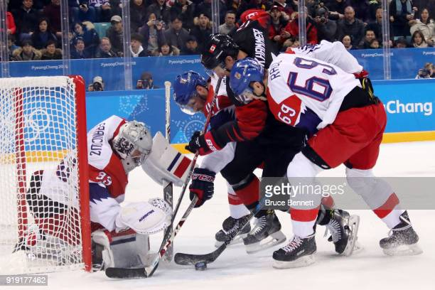 Rob Klinkhammer of Canada attempts a shot on Pavel Francouz of the Czech Republic in the first period during the Men's Ice Hockey Preliminary Round...