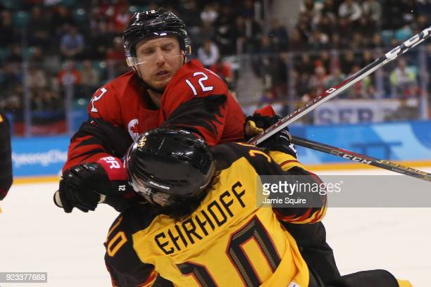 Rob Klinkhammer of Canada collides with Christian Ehrhoff of Germany during the Men's Playoffs Semifinals on day fourteen of the PyeongChang 2018...