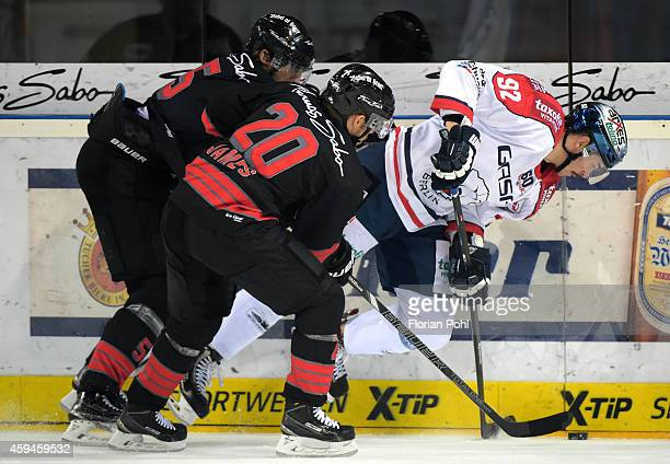 Rob Leask, Connor James of the Thomas Sabo Ice Tigers Nuernberg and Marcel Noebels of the Eisbaeren Berlin duel during the game between Thomas Sabo...