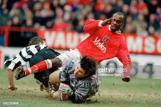 Rob Lee of Newcastle United collides with Charlton Athletic goalkeeper Andy Petterson and Richard Rufus during an FA Cup 3rd Round tie at The Valley...