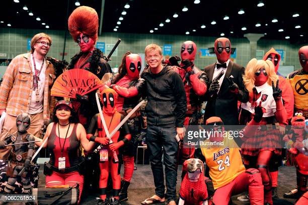 Rob Liefeld and guests dressed as versions of his character Deadpool pose onstage during Los Angeles Comic Con at Los Angeles Convention Center on...