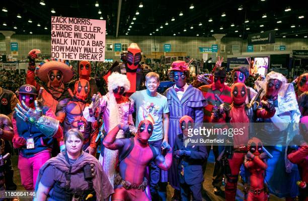 Rob Liefeld poses with cosplay Deadpools onstage at the 'Rob Liefeld Remembers Stan Lee' panel during 2019 Los Angeles Comic Con at Los Angeles...
