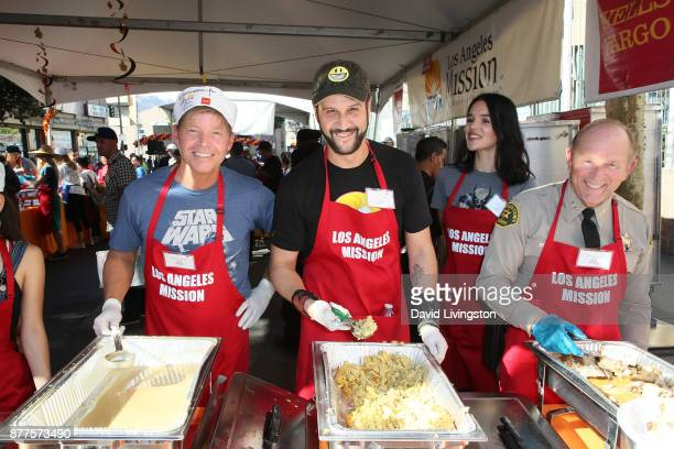 Rob Liefeld Stefan Kapicic Ivana Horvat and Jim McDonnell are seen at the Los Angeles Mission Thanksgiving Meal for the homeless at the Los Angeles...