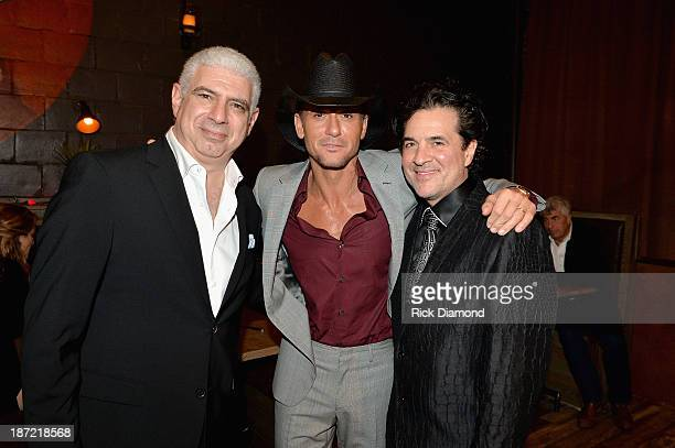 Rob Light of Creative Artists Agency Tim McGraw and Scott Borchetta attend the Big Machine Label Group CMA Awards after party on November 6 2013 in...