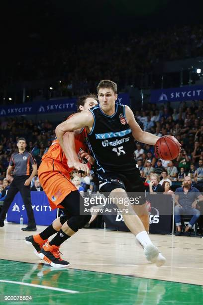 Rob Loe of the Breakers drives past Alex Loughton of the Taipans during the round 13 NBL match between the New Zealand Breakers and the Cairns...