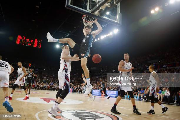 Rob Loe of the Breakers dunks on Harry Froling of the 36ers during the round 11 NBL match between the New Zealand Breakers and the Adelaide 36ers at...
