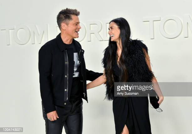 Rob Lowe and Demi Moore attend the Tom Ford AW20 Show at Milk Studios on February 07 2020 in Hollywood California
