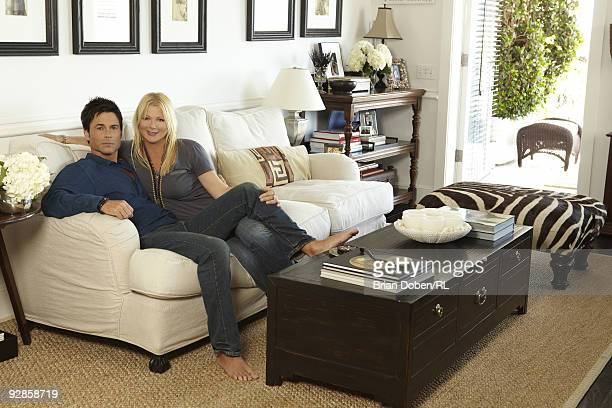 Rob Lowe and his wife Sheryl Lowe pose in the living room of their home on September 5 in Santa Barbara California All men's and women's jewelry by...
