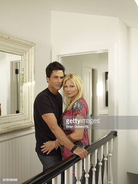 Rob Lowe and his wife Sheryl Lowe pose in their home on September 5 in Santa Barbara California All men's and women's jewelry by Sheryl Lowe...